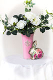 White roses in a vase. Stand on a table royalty free stock images