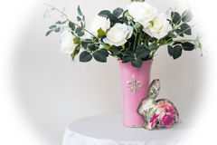 White roses in a vase. Stand on a table royalty free stock image