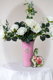 White roses in a vase. Stand on a table royalty free stock photography