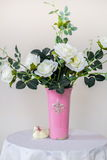 White roses in a vase. Stand on a table stock photo
