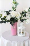 White roses in a vase. Stand on a table stock images