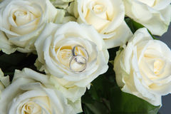 White roses at wedding. Beautiful white roses at a wedding with some decoration royalty free stock photos