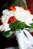 White roses wedding bouquet. White and orange roses wedding bouquet Stock Photos