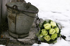 White roses wedding bouquet by the bucket. In the winter with snow Stock Images