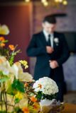 White roses wedding bouquet. Groom preparing to wedding ceremony on background. Shallow depth of field Royalty Free Stock Photo