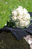 White roses wedding bouquet. On the groom's suit Stock Images