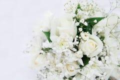 White roses wedding bouquet lying down. Isolated on white. Stock Photos