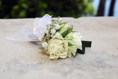 White roses wedding bouquet. At a white stone Royalty Free Stock Photography