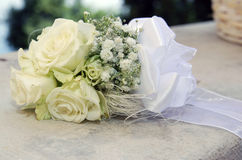 White roses wedding bouquet. At a white stone Stock Images
