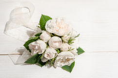 White roses on white table Royalty Free Stock Images