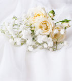White roses on a white tulle Royalty Free Stock Image