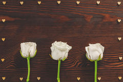 White roses and wood hearts Stock Image