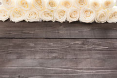 White roses are on the wooden background Royalty Free Stock Photos