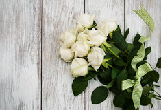 White roses on a wooden table Stock Photos