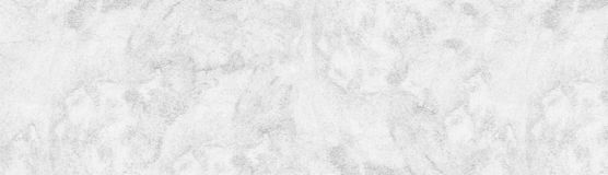 White rough concrete wall wide texture. Cement plaster surface panorama. Whitewashed panoramic background. White rough concrete wall wide texture. Fine textured royalty free stock photography