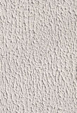White rough plaster on wall closeup Royalty Free Stock Images