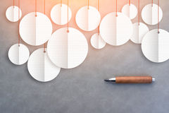 White round banner with paper cut technic and pencil on grey bac Stock Images