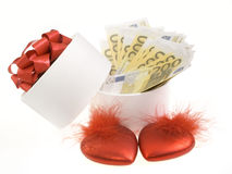 White round box with banknotes. And red hearts Royalty Free Stock Image