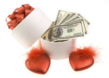 White round box with dollars. And two red hearts Stock Photography