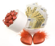 White round box with two red hearts. And banknotes Stock Photography