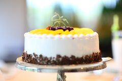 White Round Cake Topped With Yellow Slice Fruit Royalty Free Stock Photo
