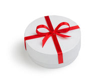 White round cilinder gift box with red bow Stock Photography