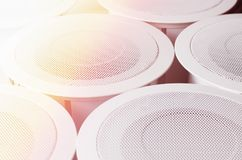 White round circle speakers near each over. Alarm system. Soft focus photo Good for security service engineering company Stock Photos
