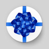 White Round Gift Box with Blue Bow and Ribbon. Vector White Round Gift Box with Shiny Blue Bow and Ribbon Top View Close up  on Background Stock Photo