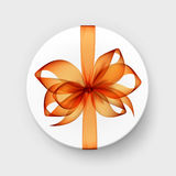 White Round Gift Box with Orange Bow and Ribbon Stock Photo
