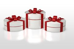 White round gift box with red ribbon Stock Image
