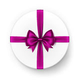 White Round Gift Box with Shiny Magenta Dark Pink Purple Satin Bow and Ribbon Top View  on White Background Stock Image