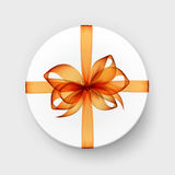 White Round Gift Box with Transparent Orange Bow and Ribbon Stock Images