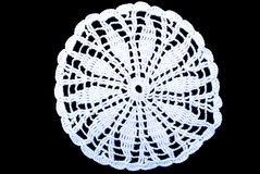 Round lace tablecloth isolated on black background. White round lace tablecloth isolated on black background. Cute out and texture for design. White pattern Stock Photos