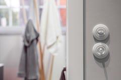 White round light switch. Close up of functional white round bathroom light switch royalty free stock photos