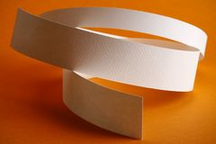 White round paper strips on orange background Royalty Free Stock Images