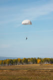 White round parachute on the background of the autumn landscape. Royalty Free Stock Image