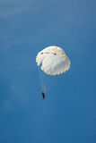 White round parachute on background blue sky. Royalty Free Stock Photography