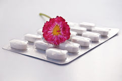 White round pill with daisy Royalty Free Stock Photo