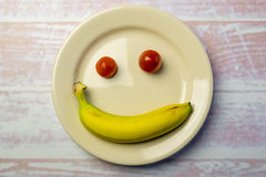White round plate with a smiley face Royalty Free Stock Images