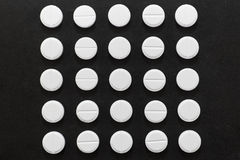 White round tablets in the shape of a square on a dark background Stock Images