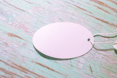 White round tag on a wooden background stock photography