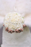 White round wedding bouquet. Bride with a white round wedding bouquet Stock Photo