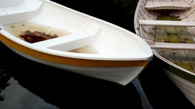 White row boat with orange linings Stock Photo