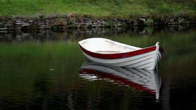 White row boat with red linings Stock Photography