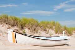 White Rowboat on Sandy Dune stock images