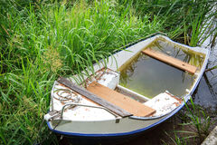White rowing boat full of water Royalty Free Stock Photography