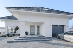 White royal residence. With garage and new silver car stock photo