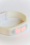 White rubber digital sports watch over white Stock Photo