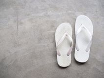 Flip Flop. White Rubber Sandals Flip Flops on Cement Background Top View royalty free stock photo