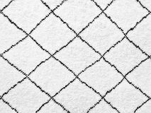 White rug with simple black lines design Stock Image